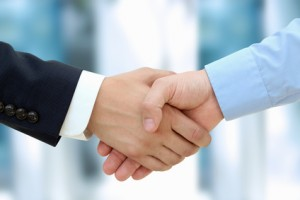 Close-up image of a firm handshake between two colleagues